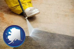 alaska pressure washing a concrete surface