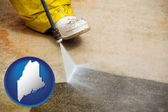 maine pressure washing a concrete surface