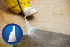 new-hampshire pressure washing a concrete surface