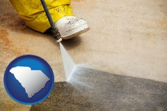south-carolina map icon and pressure washing a concrete surface