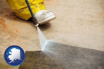 pressure washing a concrete surface - with Alaska icon
