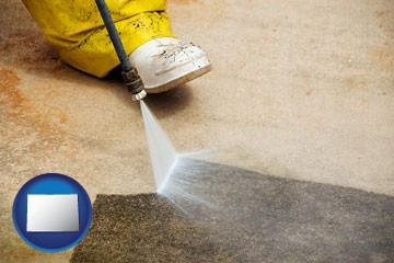 pressure washing a concrete surface - with Colorado icon