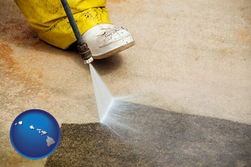 pressure washing a concrete surface - with Hawaii icon