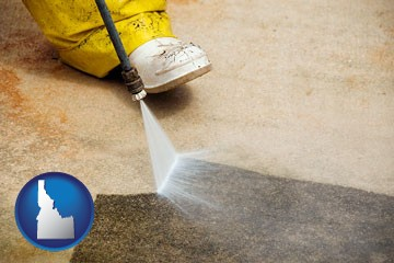 pressure washing a concrete surface - with Idaho icon