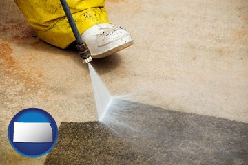 pressure washing a concrete surface - with Kansas icon
