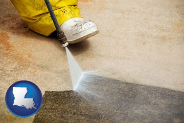 pressure washing a concrete surface - with Louisiana icon