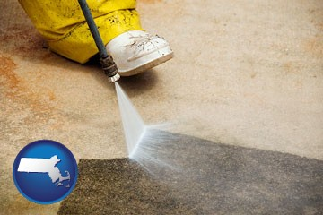 pressure washing a concrete surface - with Massachusetts icon