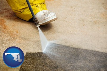 pressure washing a concrete surface - with Maryland icon