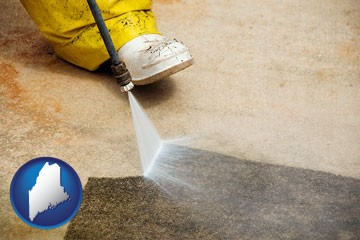 pressure washing a concrete surface - with Maine icon