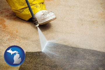 pressure washing a concrete surface - with Michigan icon