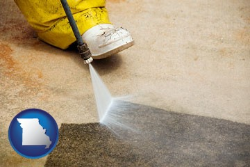 pressure washing a concrete surface - with Missouri icon