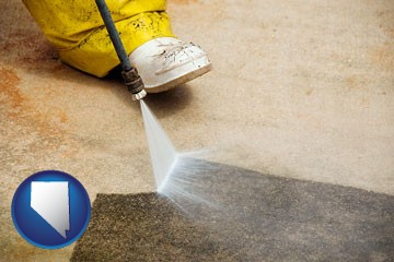 pressure washing a concrete surface - with Nevada icon