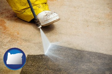pressure washing a concrete surface - with Oregon icon