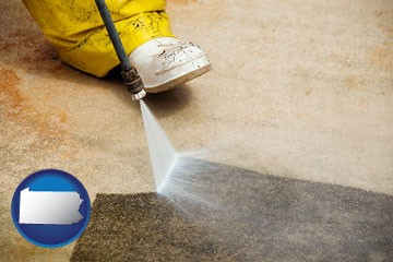 pressure washing a concrete surface - with Pennsylvania icon