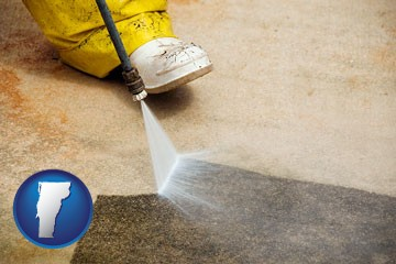 pressure washing a concrete surface - with Vermont icon