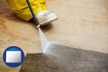 pressure washing a concrete surface - with Wyoming icon